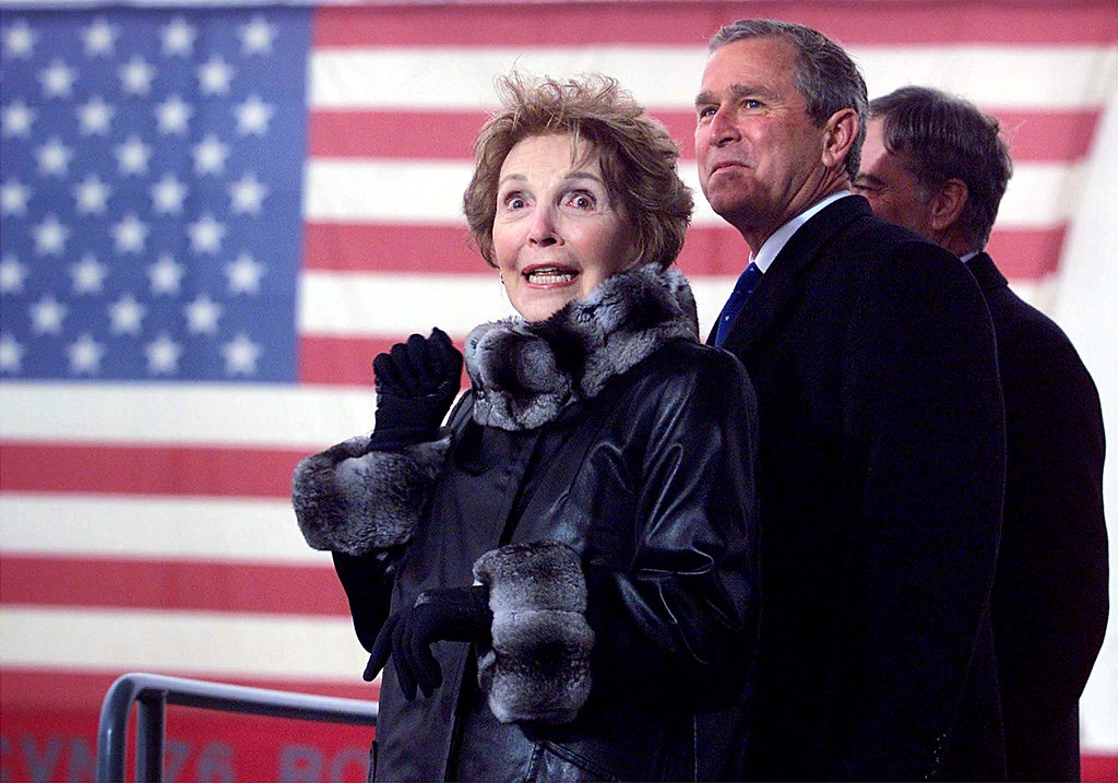 . Former US First Lady Nancy Reagan (L) along with US President George W. Bush (R) react after she christen the USS Ronald Reagan (CVN-76) aircraft carrier 04 March, 2001, in Newport News, Virginia. The ship named after the former president is christened on the 49th anniversary of their marriage and it is the last Nimitz-class nuclear aircraft carrier being built.   (STEPHEN JAFFE/AFP/Getty Images)