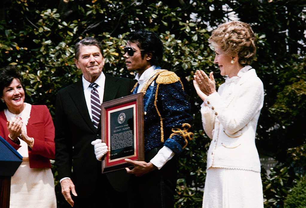 . Michael Jackson stands with President and Nancy Reagan May 14, 1984 on the south lawn of the White House prior to receiving an award from the president for his contribution to the drunk driving awareness program. (AP Photo/Scott Stewart)