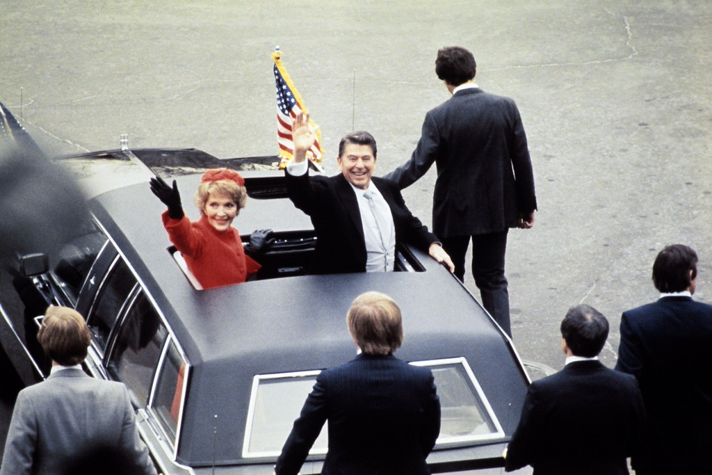 . US President Ronald Reagan (C) salutes beside his wife Nancy Reagan after being sworn in as 40th President of the United States by Chief Justice Warren Burger during inaugural ceremony, on January 20, 1981 at the Capitol in Washington, DC. (AFP/Getty Images)