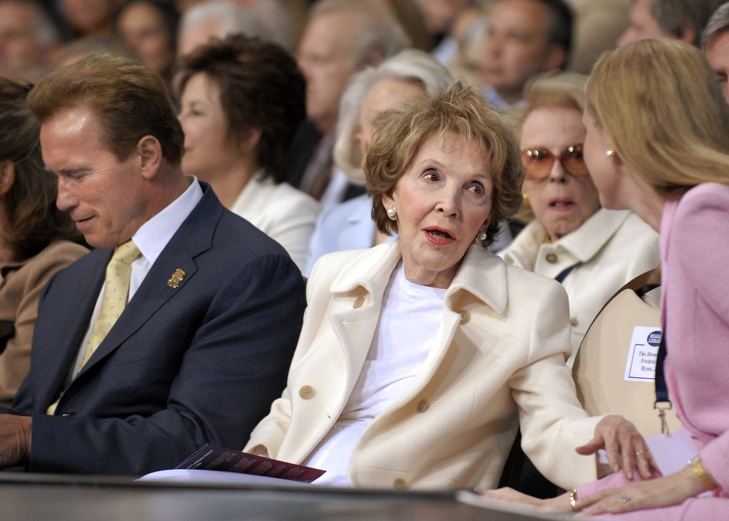. California Governor Arnold Schwarzenegger sits next to former First Lady Nancy Reagan, who hosted the major GOP Presidential Candidates, as they participated in the first Republican debate held at the Reagan Library on May 3, 2007 in Simi Valley, California. The debate included ten Republican Party presidential candidates. (Photo by Jamie Rector/Getty Images)