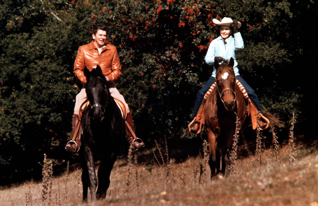 . U.S. President Ronald Reagan rides horses with his wife First Lady Nancy Reagan.