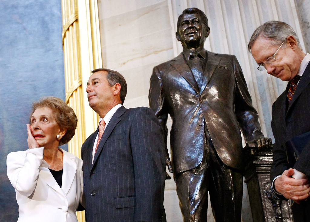 . Former U.S. first lady Nancy Reagan (L) wipes away a tear after the unveiling of a statue of former President Ronald Reagan in the Rotunda of the U.S. Capitol June 3, 2009 in Washington, DC. Also pictured (L-R) are House Minority Leader Rep. John Boehner (R-OH) (2nd L) and Senate Majority Leader Harry Reid.  (Photo by Win McNamee/Getty Images)