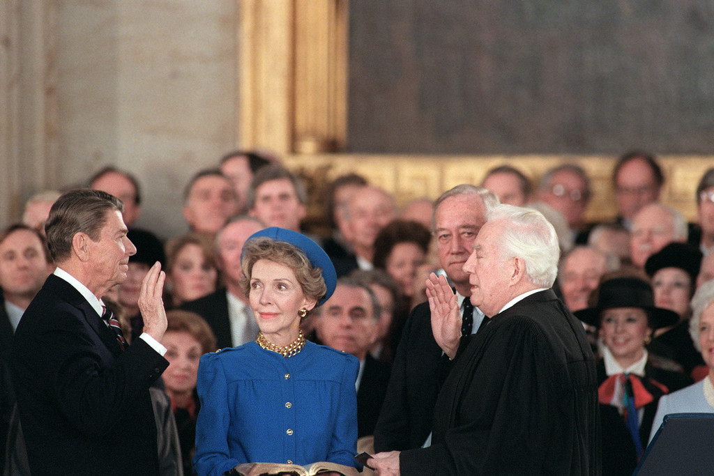 . US President Ronald Reagan (C) is sworn in as 40th President of the United States by Chief Justice Warren Burger (R) beside his wife Nancy Reagan (C) during inaugural ceremony, on January 21, 1985 in the Capitol Rotunda in Washington DC. (AFP/Getty Images)