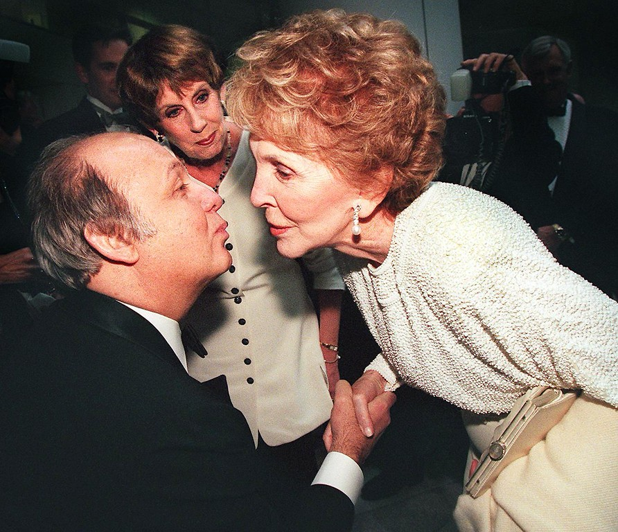 . James Brady, former press secretary to US President Ronald Reagan (L), is greeted by former US First Lady Nancy Reagan (R) May 5 in Washington DC.  Mrs. Reagan attended the gala to mark the dedication of the Ronald Reagan Building and International Trade Center. Brady was seriously injured in the 1981 assassination attempt on President Reagan.  Standing in the background at center is Brady\'s wife Sarah.  (TIM SLOAN/AFP/Getty Images)