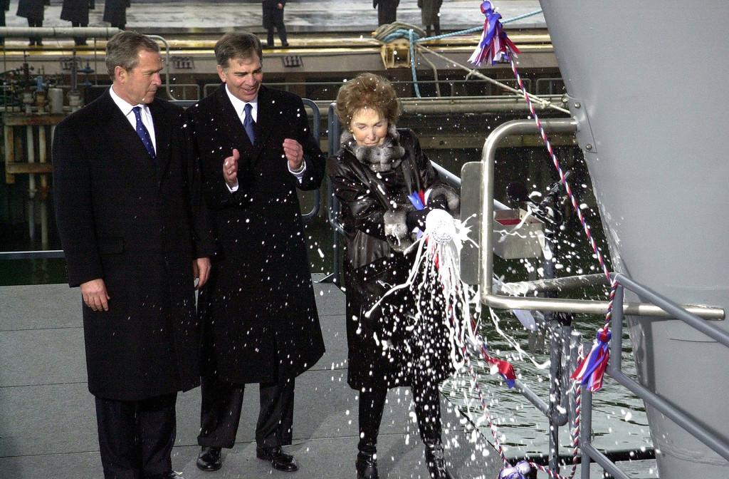 ". U.S. President George W. Bush and Chairman and Chief Executive Officer of Newport News Shipbuilding, William P. Frick watch as former First Lady, Nancy Reagan christens the U.S. Navy\'s newest nuclear powered aircraft carrier ""Ronald Reagan\"" (CVN 76) March 4, 2001at Newport News Shipbuilding in Newport News, VA. The ship is named in honor of the 40th President of the United States of America, Ronald Wilson Reagan. (Photo courtesy of U.S. Navy/Johnny Bivera/Newsmakers)"
