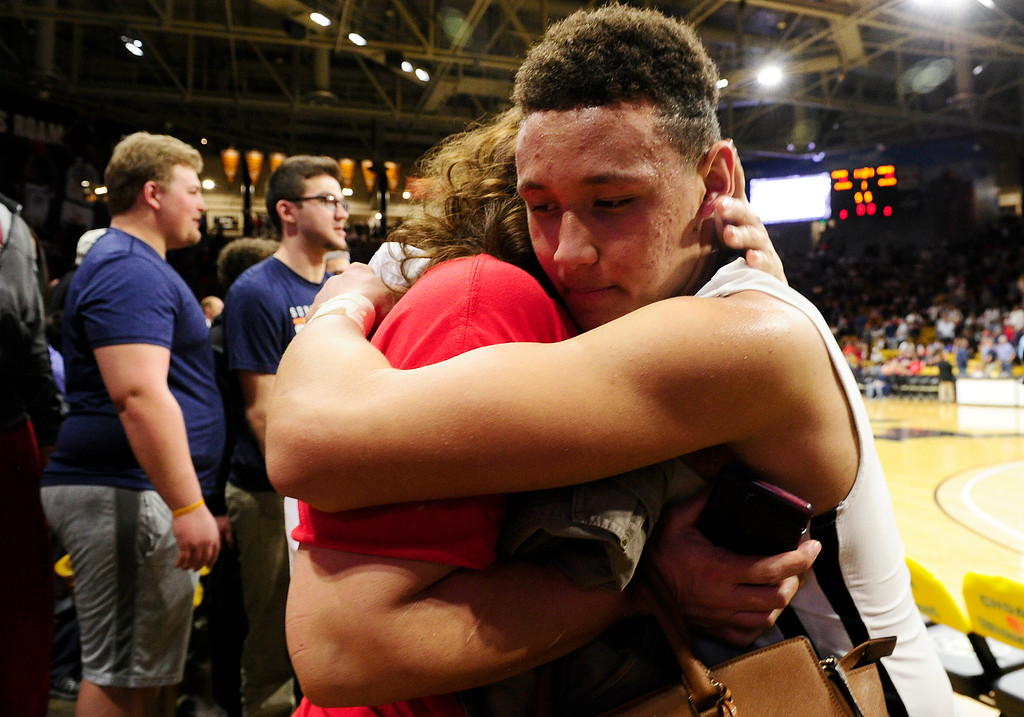 . Colbey Ross (1) of Eaglecrest hugs his mother, Mary Ross, after defeating Rangeview at the Coors Events Center on March 11, 2016 in Boulder, Colorado. Eaglecrest defeated Rangeview 58-55 to advance to the 5A finals of the Colorado state high school basketball tournament.  (Photo by Brent Lewis/The Denver Post)