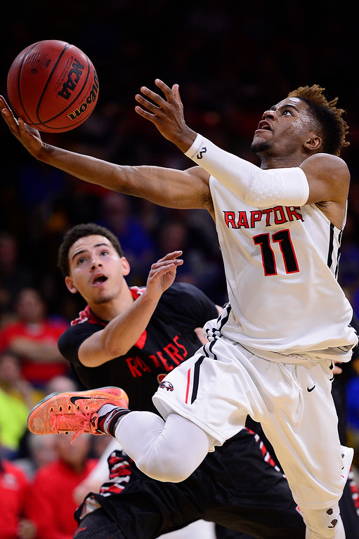 . Elijah Wilson (11) of Eaglecrest puts up a shot before Marquis Kraemer (22) of Rangeview could defend during the third quarter at the Coors Events Center on March 11, 2016 in Boulder, Colorado. Eaglecrest defeated Rangeview 58-55 to advance to the 5A finals of the Colorado state high school basketball tournament.  (Photo by Brent Lewis/The Denver Post)