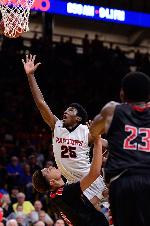 . Ikenna Ozor (25) of Eaglecrest goes up for a shot while making contact with Jalen Guidry (C) (4) of Rangeview during the fourth quarter at the Coors Events Center on March 11, 2016 in Boulder, Colorado. Eaglecrest defeated Rangeview 58-55 to advance to the 5A finals of the Colorado state high school basketball tournament.  (Photo by Brent Lewis/The Denver Post)