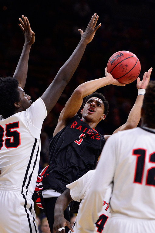 . Elijah Blake (15) of Rangeview shoots around the arms of Ikenna Ozor (25) of Eaglecrest during the first quarter at the Coors Events Center on March 11, 2016 in Boulder, Colorado. (Photo by Brent Lewis/The Denver Post)