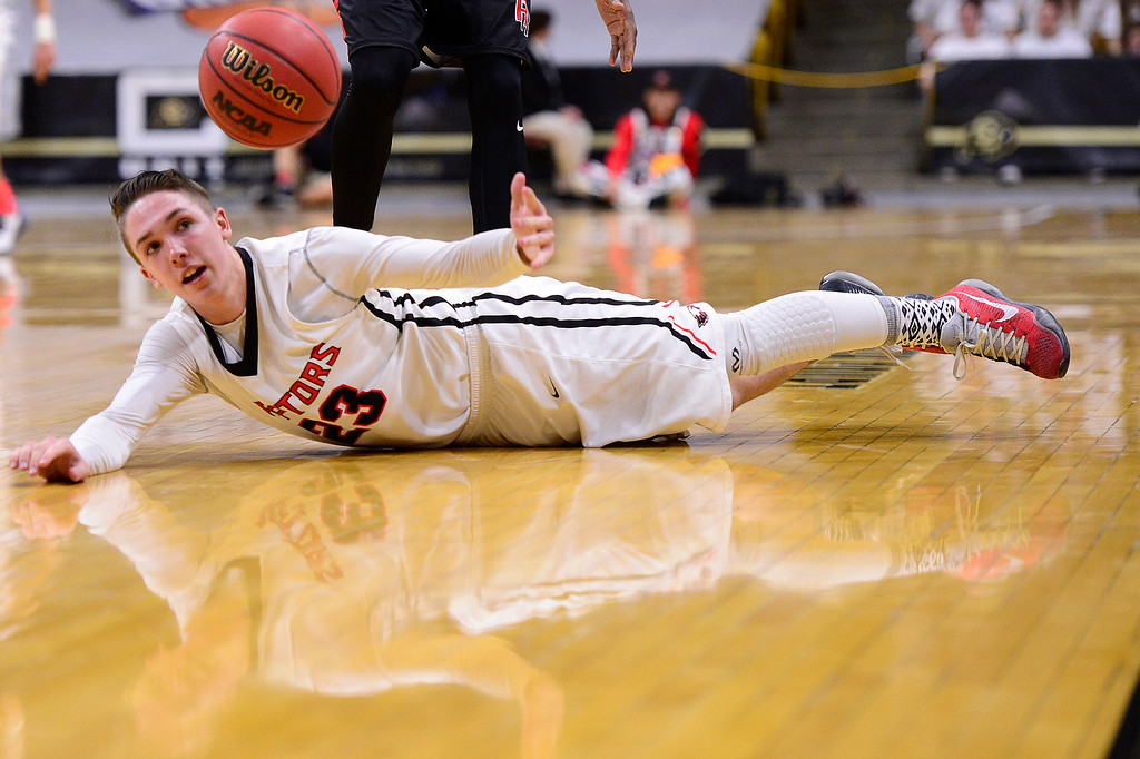 . Austin Forsberg (23) of Eaglecrest tries to grab the ball after being fouled during the fourth quarter at the Coors Events Center on March 11, 2016 in Boulder, Colorado. Eaglecrest defeated Rangeview 58-55 to advance to the 5A finals of the Colorado state high school basketball tournament.  (Photo by Brent Lewis/The Denver Post)