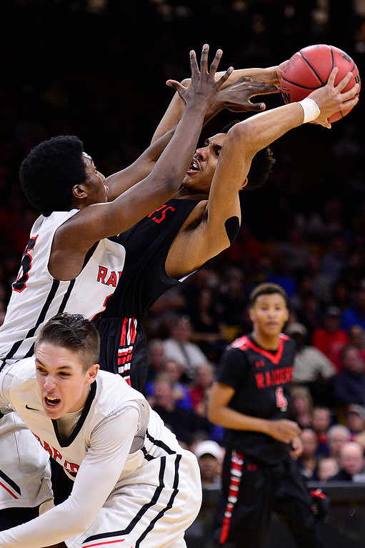 . Elijah Blake (15) of Rangeview looks to shoot over Ikenna Ozor (25) of Eaglecrest during the first quarter at the Coors Events Center on March 11, 2016 in Boulder, Colorado. (Photo by Brent Lewis/The Denver Post)