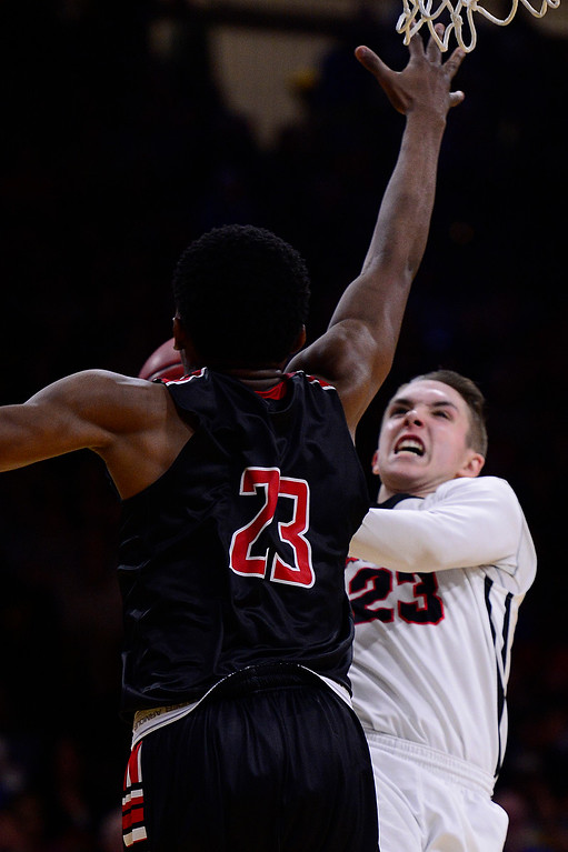 . Austin Forsberg (23) of Eaglecrest tries to move around the defense of Elijah Reed (23) of Rangeview during the fourth quarter at the Coors Events Center on March 11, 2016 in Boulder, Colorado. Eaglecrest defeated Rangeview 58-55 to advance to the 5A finals of the Colorado state high school basketball tournament.  (Photo by Brent Lewis/The Denver Post)