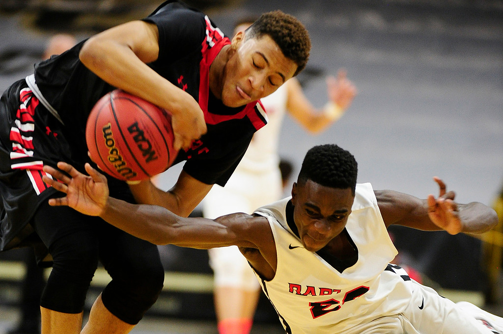 . Jalen Guidry (4) of Rangeview fights with Jalaughn Jackson (22) of Eaglecrest over a loose ball during the third quarter at the Coors Events Center on March 11, 2016 in Boulder, Colorado. Eaglecrest defeated Rangeview 58-55 to advance to the 5A finals of the Colorado state high school basketball tournament.  (Photo by Brent Lewis/The Denver Post)
