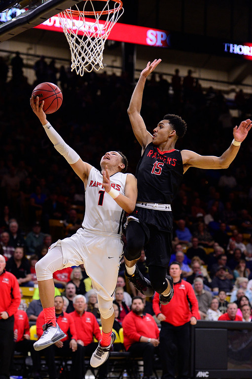 . Colbey Ross (1) of Eaglecrest goes for a lay up while Elijah Blake (15) of Rangeview defends during the fourth quarter at the Coors Events Center on March 11, 2016 in Boulder, Colorado. Eaglecrest defeated Rangeview 58-55 to advance to the 5A finals of the Colorado state high school basketball tournament.  (Photo by Brent Lewis/The Denver Post)