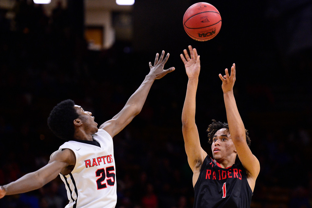 . Calvin Collins (1) of Rangeview shoots over the hand of Ikenna Ozor (25) of Eaglecrest during the second quarter at the Coors Events Center on March 11, 2016 in Boulder, Colorado.  (Photo by Brent Lewis/The Denver Post)