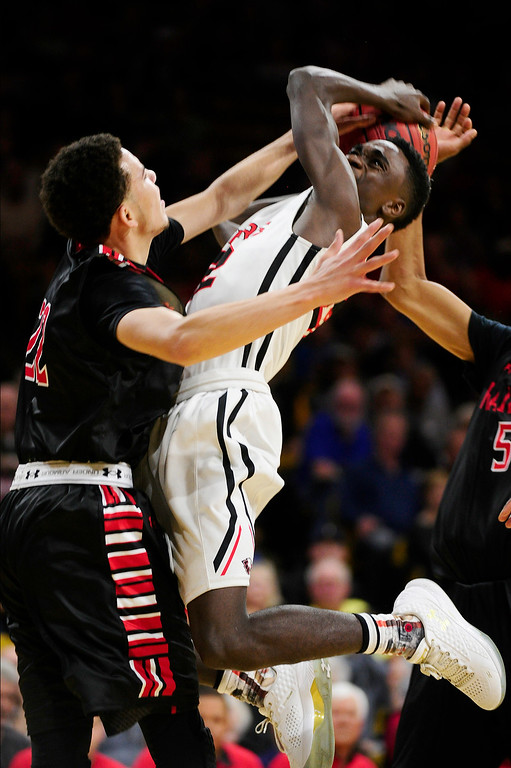 . Marquis Kraemer (22) of Rangeview goes up to block the shot of Jalaughn Jackson (22) of Eaglecrest during the fourth quarter at the Coors Events Center on March 11, 2016 in Boulder, Colorado. Eaglecrest defeated Rangeview 58-55 to advance to the 5A finals of the Colorado state high school basketball tournament.  (Photo by Brent Lewis/The Denver Post)