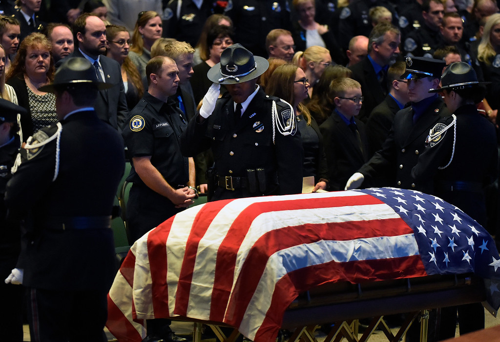 """. ARVADA, CO - MARCH 14: Police and sheriff deputies salute the flag draped casket at the memorial service for Park County Deputy Corporal Nathaniel \""""Nate\"""" Carrigan at Faith Bible Chapel on March 14, 2016 in Arvada, Colorado. Carrigan was killed in the line of duty while serving a warrant in Bailey, Colorado on February 24, 2016. (Photo by Helen H. Richardson/The Denver Post)"""