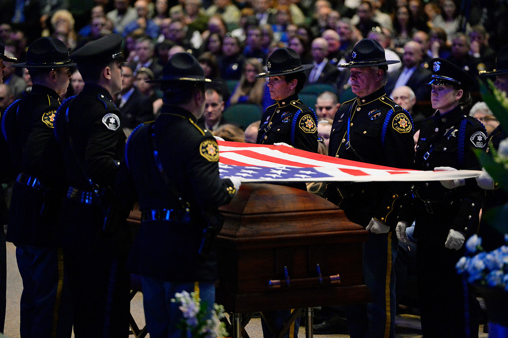 """. ARVADA, CO - MARCH 14: Members of the Colorado Police Honor Guard fold the American flag off of the casket  during the memorial service for Park County Deputy Corporal Nathaniel \""""Nate\"""" Carrigan at Faith Bible Chapel on March 14, 2016 in Arvada, Colorado. Carrigan was killed in the line of duty while serving a warrant in Bailey, Colorado on February 24, 2016. (Photo by Helen H. Richardson/The Denver Post)"""