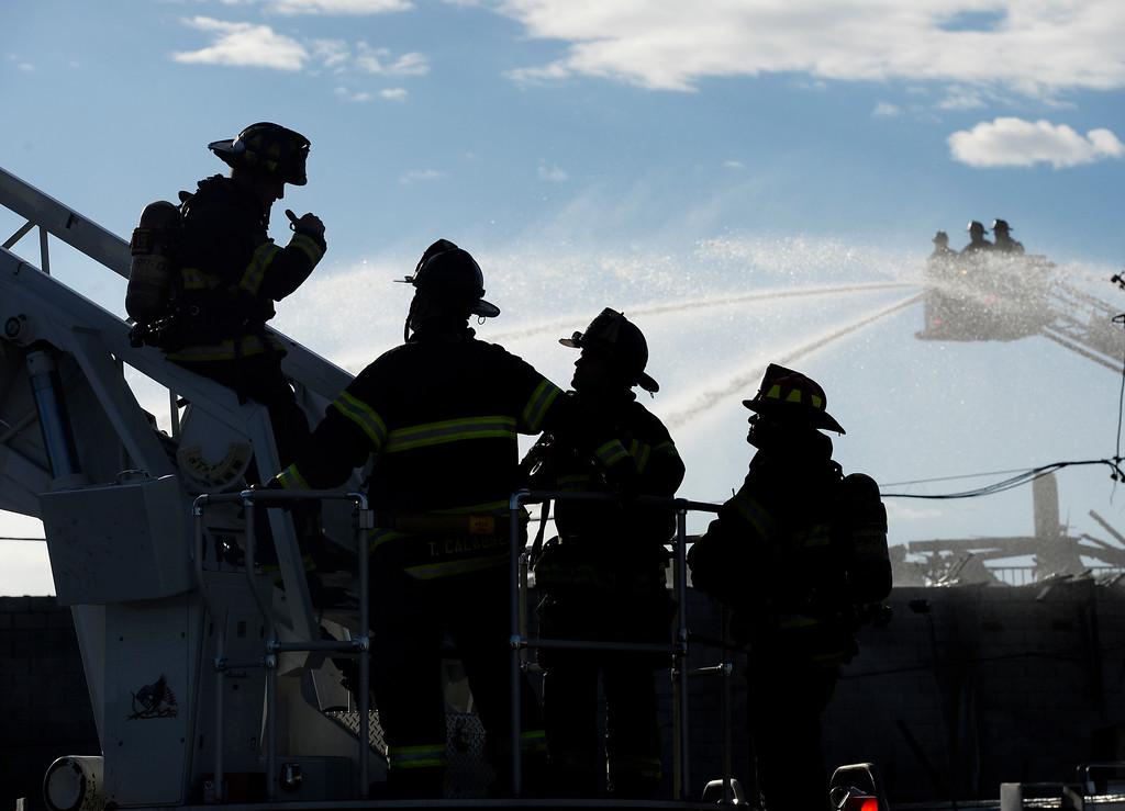 . A two alarm fire broke out at the abandoned  Rockies Inn at I-25 and Evans in Denver. Denver Fire Fighters from Station 19 man a ladder as another works in the background as they work to put it out on Friday, April 1, 2016. (Photo by Cyrus McCrimmon/ The Denver Post)