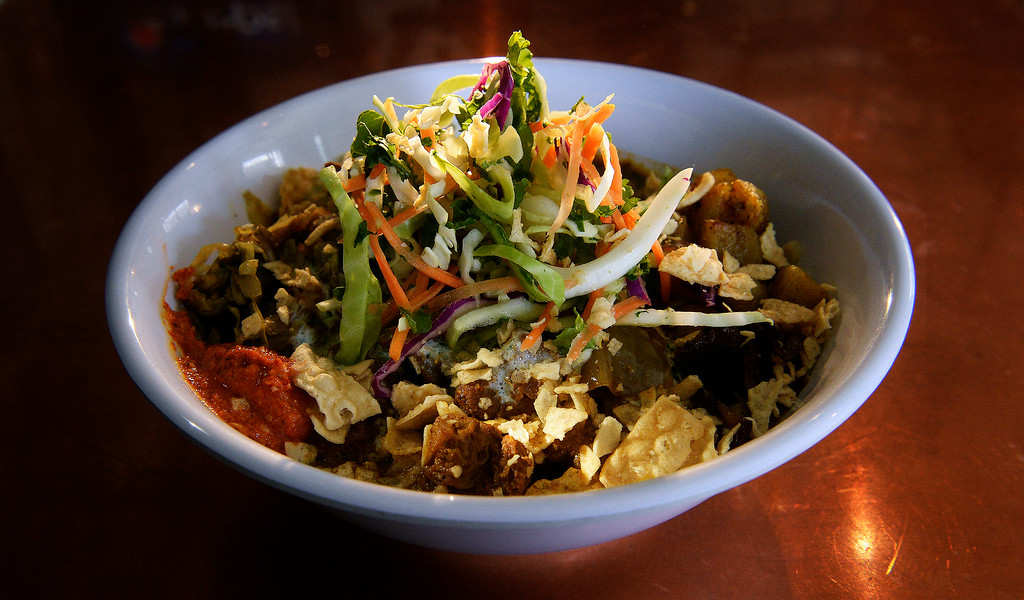 . The beef curry bowl at  Biju\'s Little Curry Shop  in Denver. They serve southern Indian style veggie, chicken or beef curry bowls.  The new restaurant at 1441 26th Street, was photographed on Thursday, March 26, 2015.   (Photo by Cyrus McCrimmon/The Denver Post )