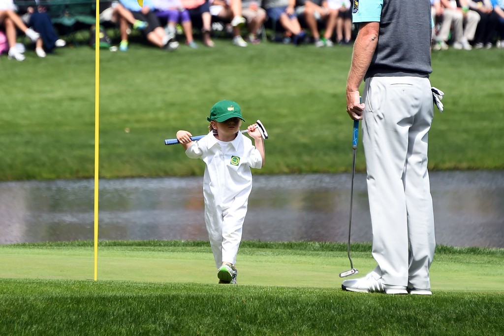 . US golfer Brandt Snedeker\'s son Austin walks to his father on the 9th green during the Par 3 contest prior to the start of the 80th Masters of Tournament at the Augusta National Golf Club on April 6, 2016, in Augusta, Georgia. JIM WATSON/AFP/Getty Images