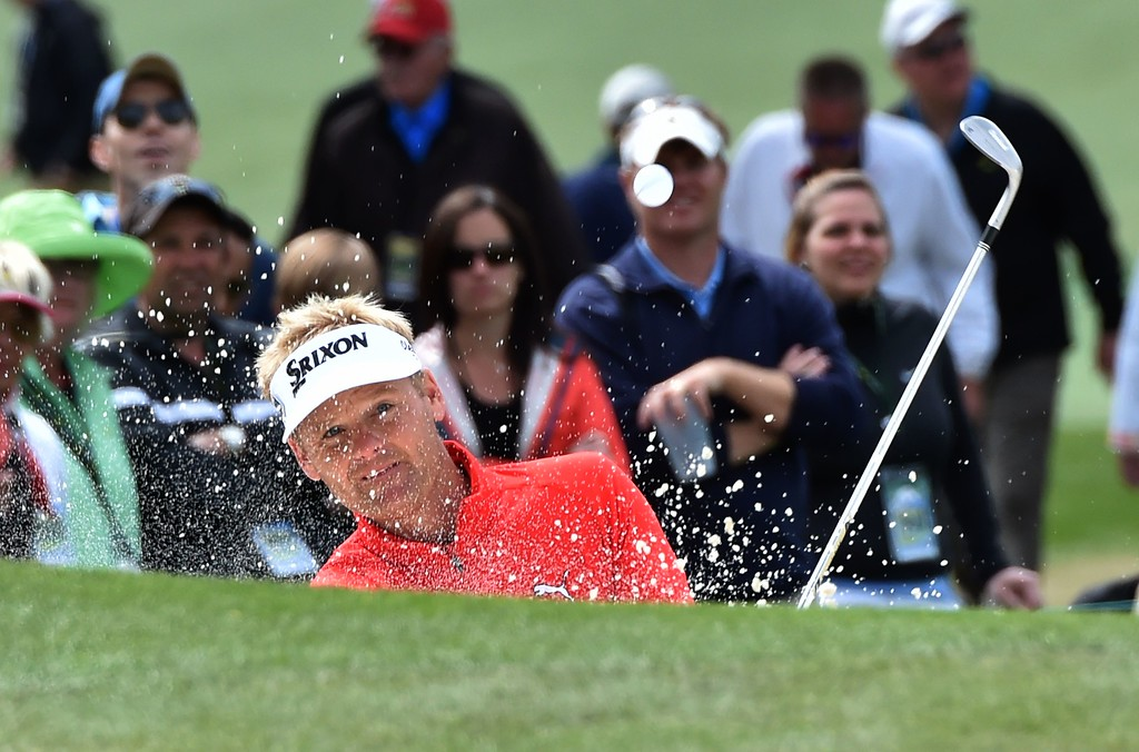 . Denmark\'s Soren Kjeldsen hits out of a bunker on the 7th hole during Round 4 of the 80th Masters Golf Tournament at the Augusta National Golf Club on April 10, 2016, in Augusta, Georgia. / AFP PHOTO / Nicholas KammNICHOLAS KAMM/AFP/Getty Images