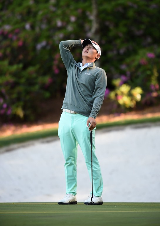 . New Zealand\'s Danny Lee reacts during Round 3 of the 80th Masters Golf Tournament at the Augusta National Golf Club on April 9, 2016, in Augusta, Georgia. / AFP PHOTO / Jim WatsonJIM WATSON/AFP/Getty Images