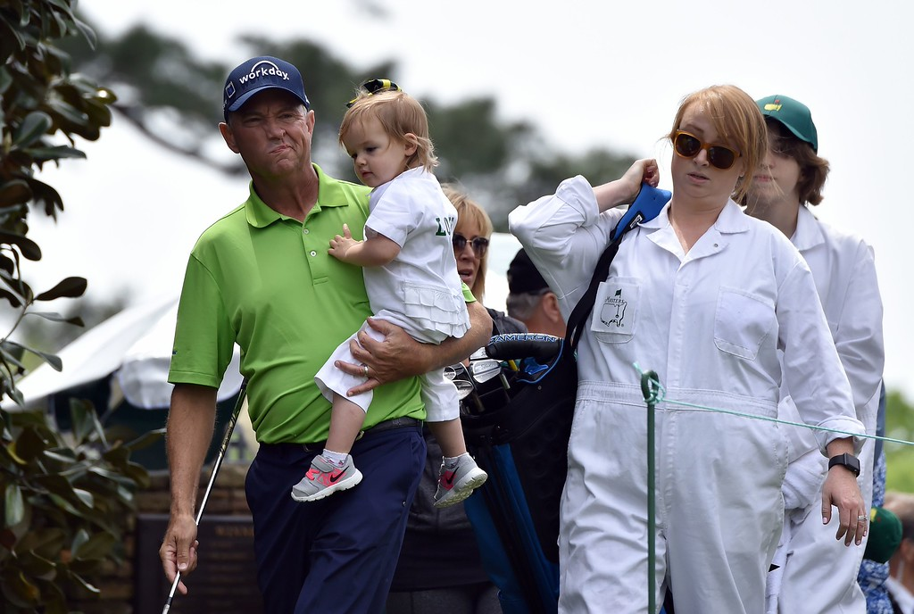 . US golfer Davis Love III walks with his family after teeing off during the Par 3 contest prior to the start of the 80th Masters of Tournament at the Augusta National Golf Club on April 6, 2016, in Augusta, Georgia.  NICHOLAS KAMM/AFP/Getty Images