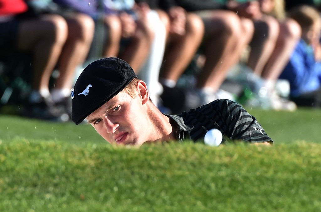 . TOPSHOT - US golfer Bryson DeChambeau hits out of a bunker on the 18th green during Round 3 of the 80th Masters Golf Tournament at the Augusta National Golf Club on April 9, 2016, in Augusta, Georgia. / AFP PHOTO / Nicholas KammNICHOLAS KAMM/AFP/Getty Images