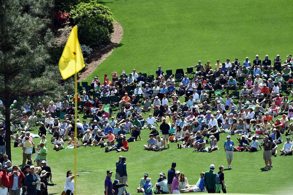 . Patrons watch the play during Round 2 of the 80th Masters Golf Tournament at the Augusta National Golf Club on April 8, 2016, in Augusta, Georgia. / AFP PHOTO / Nicholas  KAMM/AFP/Getty Images