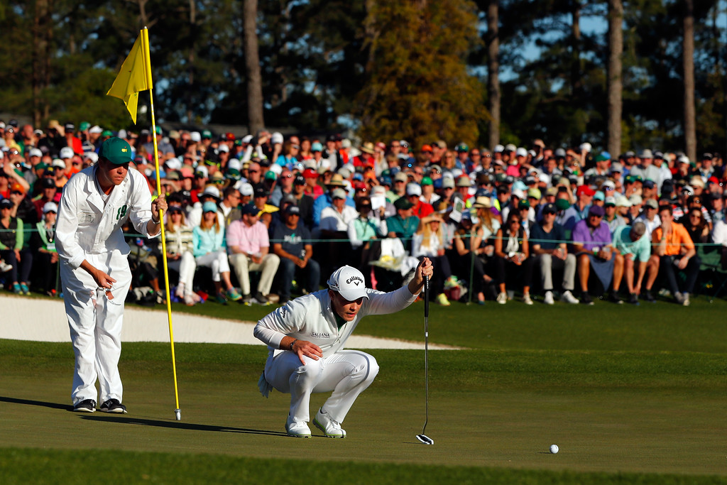 . AUGUSTA, GEORGIA - APRIL 10:  Danny Willett of England and caddie Jonathan Smart line up a putt on the 18th green during the final round of the 2016 Masters Tournament at Augusta National Golf Club on April 10, 2016 in Augusta, Georgia.  (Photo by Kevin C. Cox/Getty Images)
