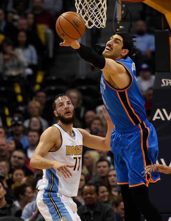 . Oklahoma City Thunder center Enes Kanter (11) reaches out for a rebound on Denver Nuggets center Joffrey Lauvergne (77) during the second quarter April 5, 2016 at Pepsi Center. (Photo By John Leyba/The Denver Post)