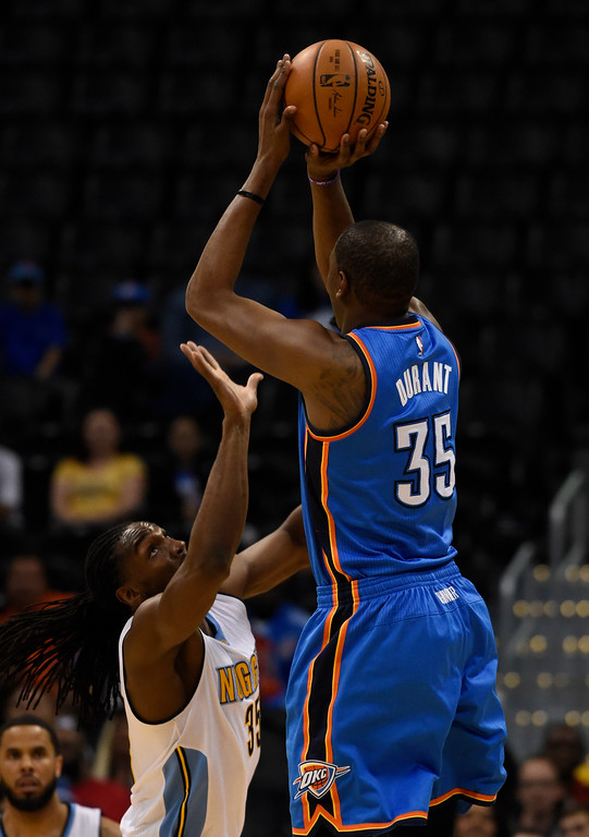 . Oklahoma City Thunder forward Kevin Durant (35) takes a shot over Denver Nuggets forward Kenneth Faried (35) during the first quarter April 5, 2016 at Pepsi Center. (Photo By John Leyba/The Denver Post)
