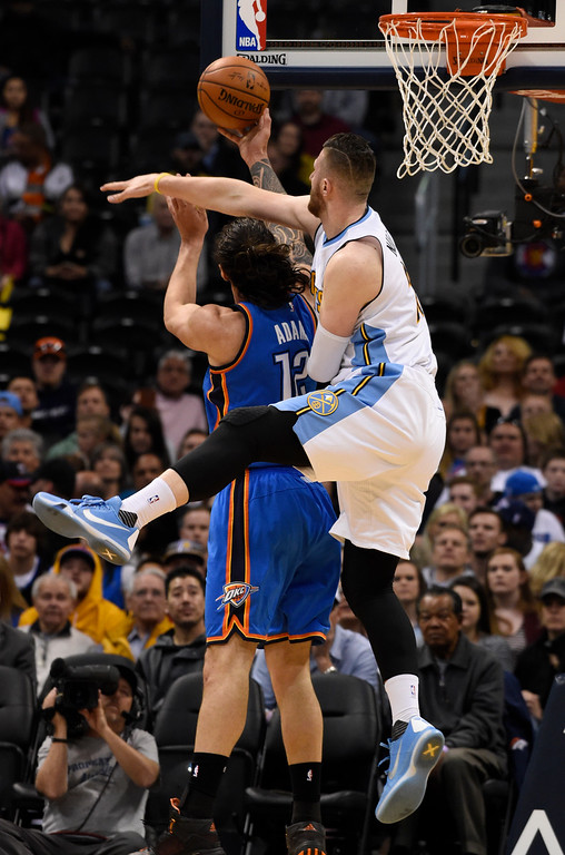 . Denver Nuggets center Joffrey Lauvergne (77) swipes a the ball as Oklahoma City Thunder center Steven Adams (12) goes up for a shot during the first quarter April 5, 2016 at Pepsi Center. (Photo By John Leyba/The Denver Post)