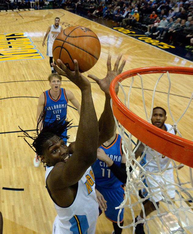. Denver Nuggets forward Kenneth Faried (35) gets an easy layup against the Oklahoma City Thunder  April 5, 2016 at Pepsi Center. (Photo By John Leyba/The Denver Post)