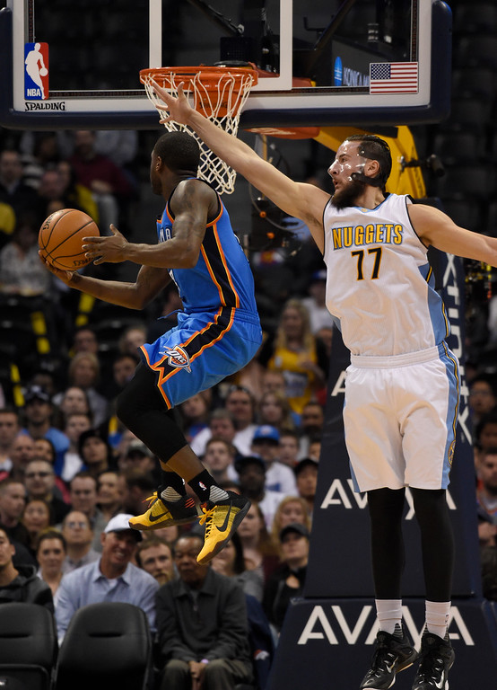 . Oklahoma City Thunder guard Dion Waiters (3) flies to the basket past Denver Nuggets center Joffrey Lauvergne (77) for a reverse layup during the second quarter April 5, 2016 at Pepsi Center. (Photo By John Leyba/The Denver Post)