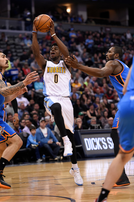 . Denver Nuggets guard Emmanuel Mudiay (0) drives to the basket against the Oklahoma City Thunder during the first quarter April 5, 2016 at Pepsi Center. (Photo By John Leyba/The Denver Post)