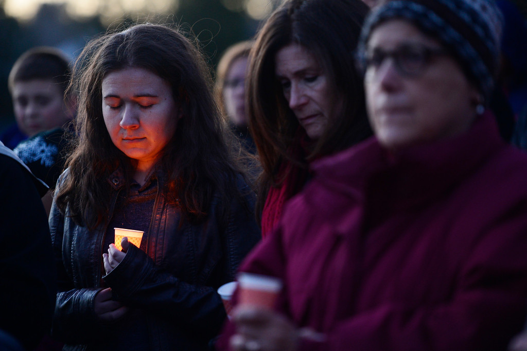 . Members of the community pray during a vigil for Dr. Kenneth Atkinson on April 5, 2016 in Centennial, Colorado. Close to 400 people showed up to pay their respects to Dr. Atkinson, who lost his life trying to protect a woman whose husband shot her. (Photo by Brent Lewis/The Denver Post)