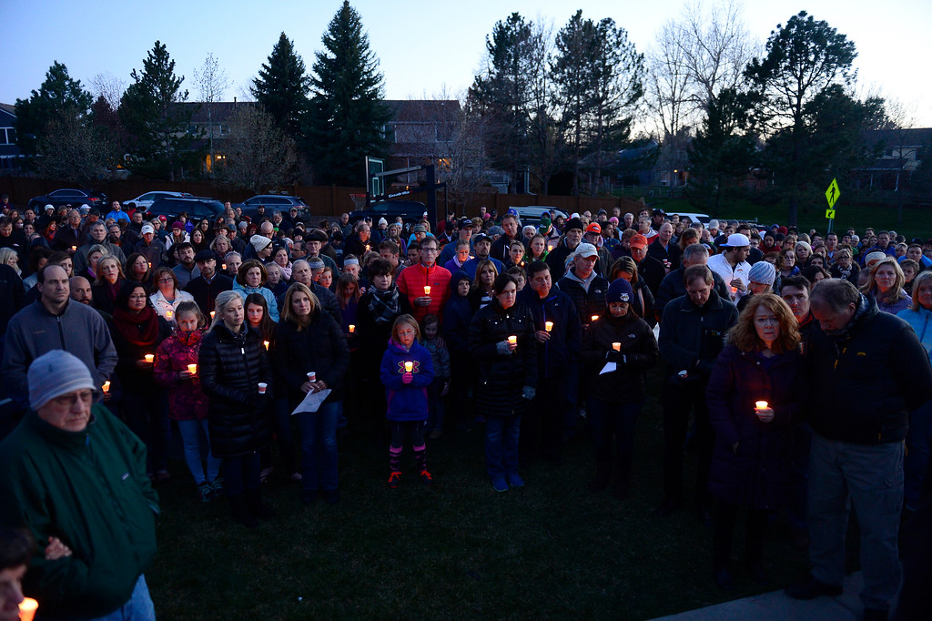 . People gather for a prayer during a vigil for Dr. Kenneth Atkinson on April 5, 2016 in Centennial, Colorado. Close to 400 people showed up to pay their respects to Dr. Atkinson, who lost his life trying to protect a woman whose husband shot her. (Photo by Brent Lewis/The Denver Post)