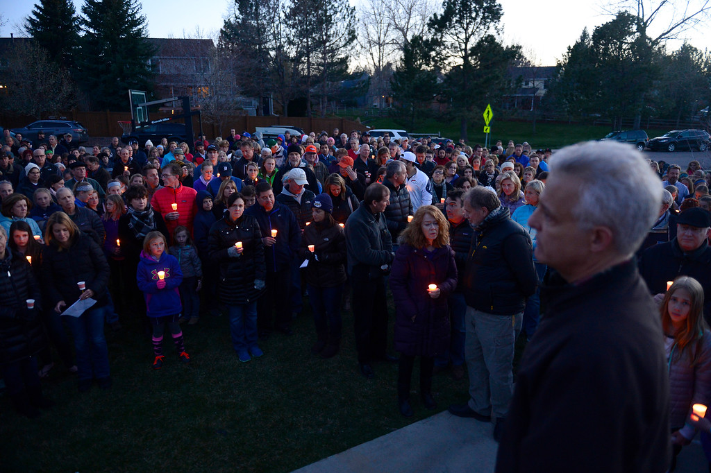 . Members of the community come together to pray for the Atkinson family during a vigil for Dr. Kenneth Atkinson on April 5, 2016 in Centennial, Colorado. Close to 400 people showed up to pay their respects to Dr. Atkinson, who lost his life trying to protect a woman whose husband shot her. (Photo by Brent Lewis/The Denver Post)