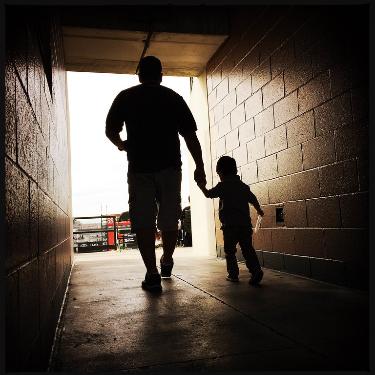 . A father and son make their way onto the third concourse. #rockies #openingday � @shootsethshoot  Denver post photographer Seth McConnell covered the Colorado Rockies opening day, on April 8, 2016, using the photo app Hipstamatic and publishing on Instagram.