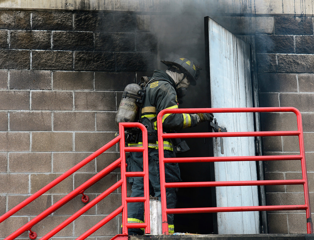 . The students and trainers enter the smoke-filled training building from the second floor. Douglas County School District students enrolled in the Fire Science program join firefighters in search and rescue and extinguishment scenarios at the South Metro Fire Rescue Training Center in Parker. The students have been training all year with the firefighters who have all volunteered their time to help train the students through this program. (Photo by Kathryn Scott Osler/The Denver Post)