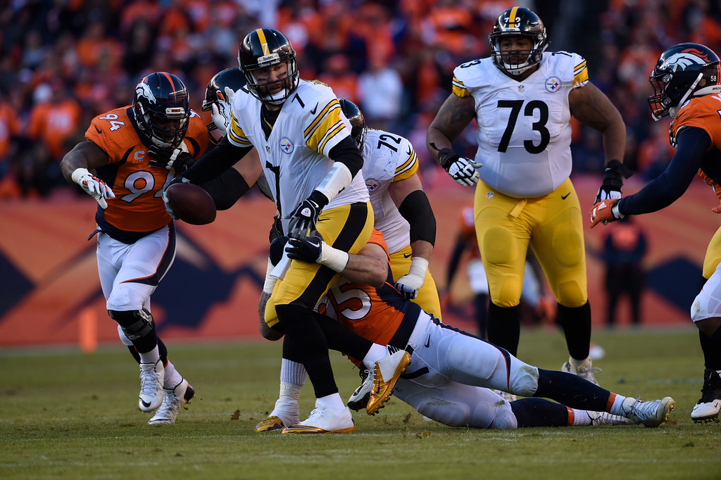 . Denver Broncos defensive end Derek Wolfe (95) wraps up Pittsburgh Steelers quarterback Ben Roethlisberger (7) for a sack during the second quarter January 17, 2016 in the Divisional Round Playoff game at Sports Authority Field at Mile High Stadium. (Photo By Helen Richardson/The Denver Post)
