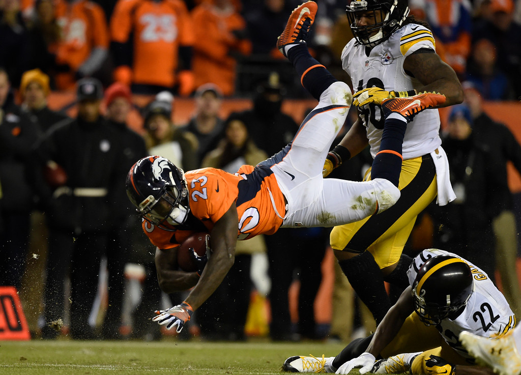 . Denver Broncos running back Ronnie Hillman (23) gets up ended by Pittsburgh Steelers cornerback William Gay (22) during the fourth quarter January 17, 2016 in the Divisional Round Playoff game at Sports Authority Field at Mile High Stadium. (Photo By Helen Richardson/The Denver Post)
