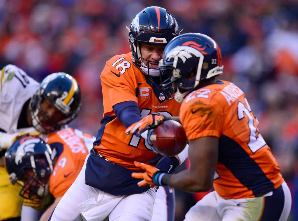. Denver Broncos quarterback Peyton Manning (18) hands off to Denver Broncos running back Ronnie Hillman (23) during the second quarter against the Pittsburgh Steelers January 17, 2016 in the Divisional Round Playoff game at Sports Authority Field at Mile High Stadium. (Photo By Eric Lutzens/The Denver Post)