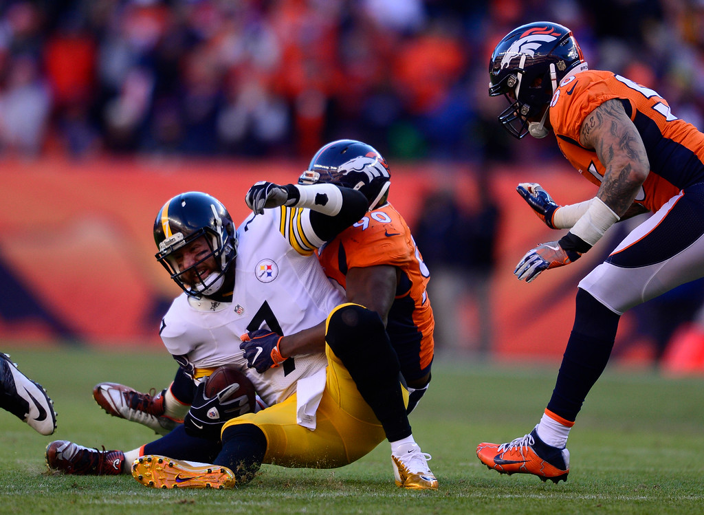 . Denver Broncos defensive end Antonio Smith (90) sacks Pittsburgh Steelers quarterback Ben Roethlisberger (7) during the second quarter January 17, 2016 in the Divisional Round Playoff game at Sports Authority Field at Mile High Stadium. (Photo By Eric Lutzens/The Denver Post)