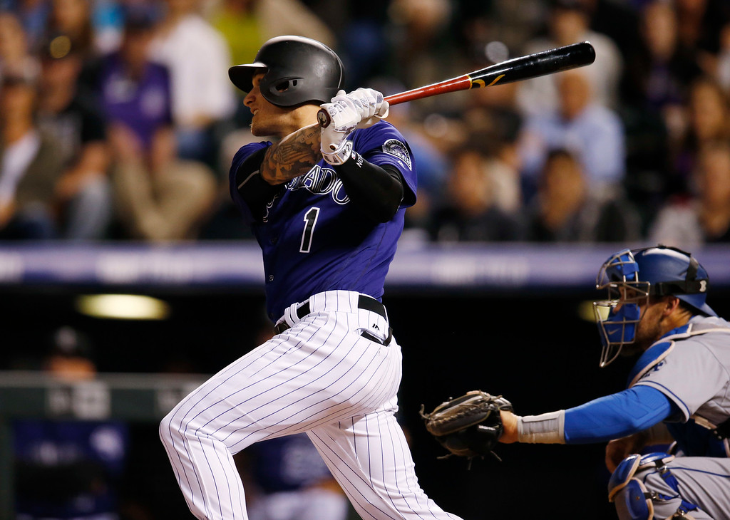 . Colorado Rockies\' Brandon Barnes watches his two-run triple off Los Angeles Dodgers relief pitcher Chris Hatcher during the eighth inning of a baseball game Friday, April 22, 2016, in Denver. (AP Photo/David Zalubowski)