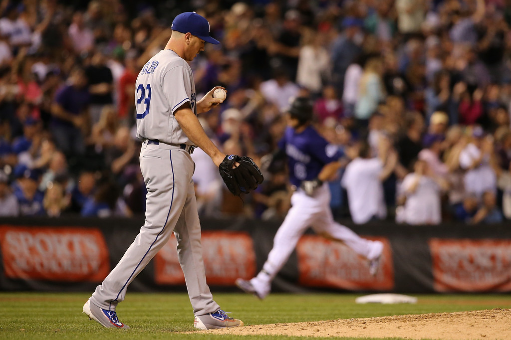 . DENVER, CO - APRIL 22:  Starting pitcher Scott Kazmir #29 of the Los Angeles Dodgers returns to the mound as Ryan Raburn #6 of the Colorado Rockies rounds the bases on his two run home to take a 4-3 lead in the fourth inning at Coors Field on April 22, 2016 in Denver, Colorado.  (Photo by Doug Pensinger/Getty Images)