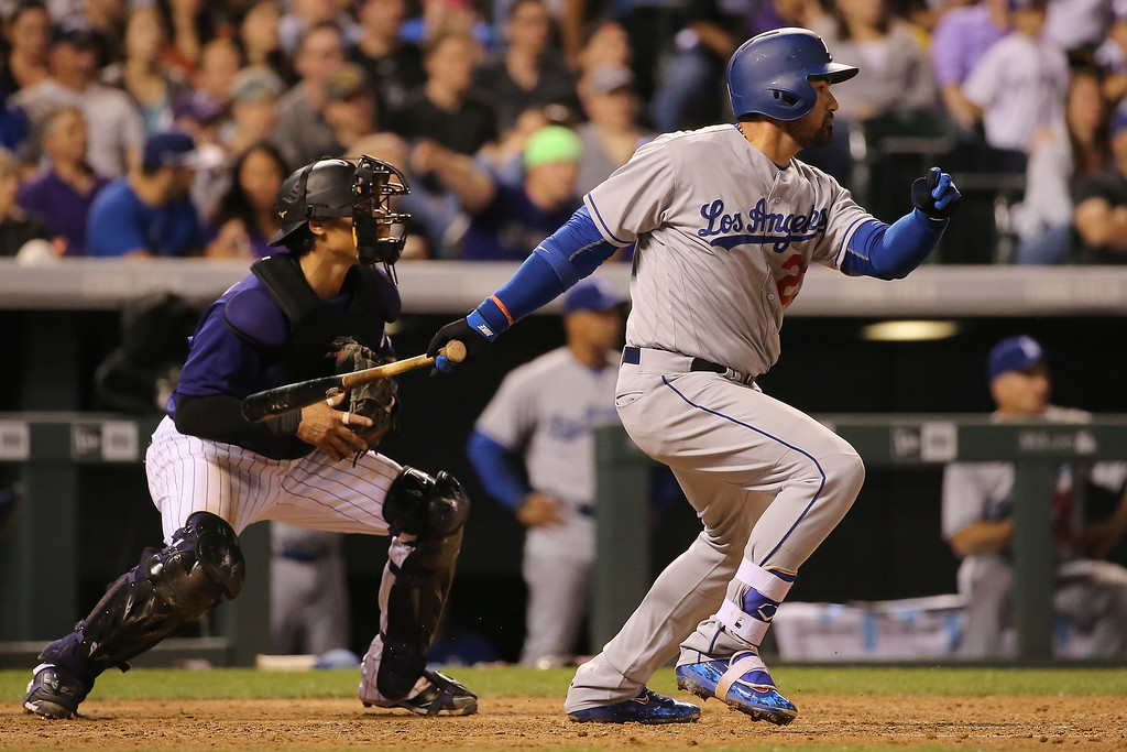 . DENVER, CO - APRIL 22:  Adrian Gonzalez #23 of the Los Angeles Dodgers hits a two RBI single off of Jon Gray #55 of the Colorado Rockies to take a 5-4 lead as catcher Tony Wolters #14 backs up the plate in the fifth inning at Coors Field on April 22, 2016 in Denver, Colorado. (Photo by Doug Pensinger/Getty Images)