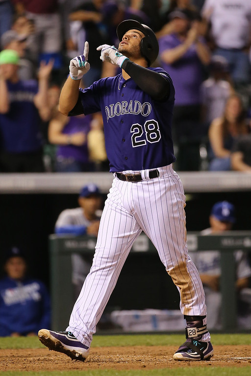 . DENVER, CO - APRIL 22:  Nolan Arenado #28 of the Colorado Rockies celebrates his solo home run off of Scott Kazmir #29 of the Los Angeles Dodgers as the Dodgers held a 3-2 lead in the fourth inning at Coors Field on April 22, 2016 in Denver, Colorado. (Photo by Doug Pensinger/Getty Images)